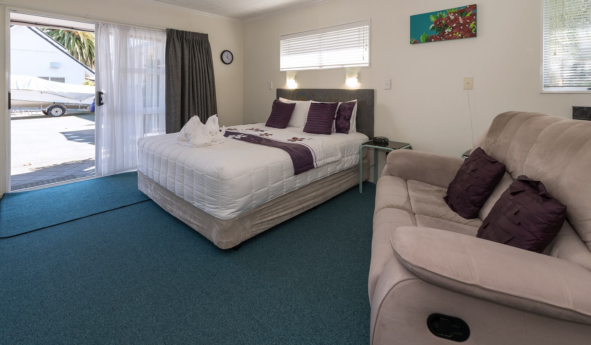 Lounge and Bed - Unit 16 Spa Studio | Palm Court Rotorua
